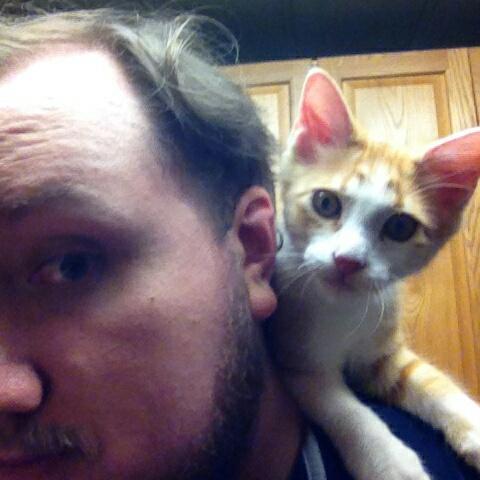 Kero climbs onto my shoulders w