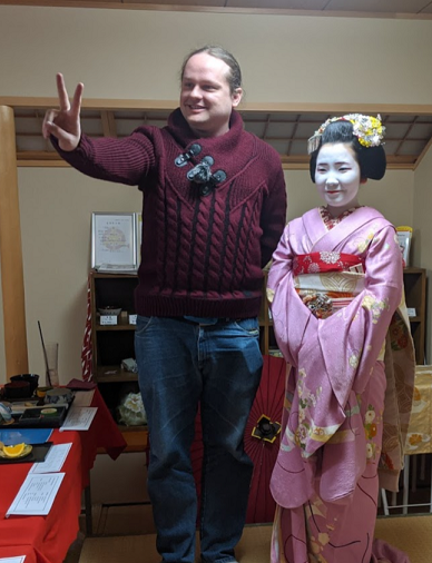 Ryan standing next to a Meiko in Japan.